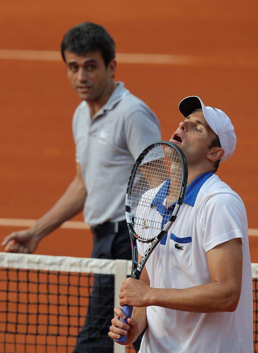 Andy Roddick's loss to 88th-ranked Nicolas Mahut dropped him to 7-10 this season, 0-4 on clay. He exited a Grand Slam tournament in the first round for the first time since 2007. (Associated Press)