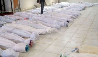 This citizen journalism image taken Saturday purports to show casualties of the assault on villages in Houla, Syria, that left more than 90 people dead. The Syrian government denied responsibility and said that its troops were targeted as well. (Shaam News Network via Associated Press)