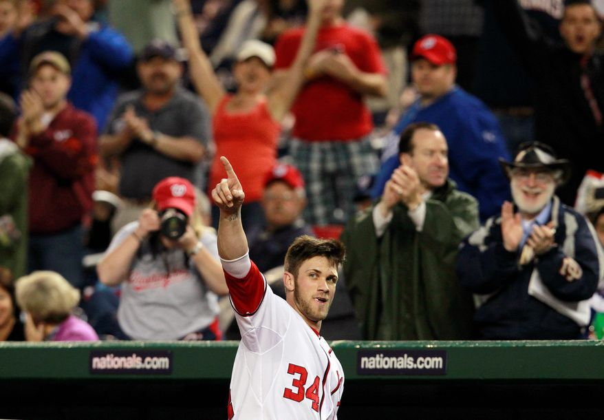 Bryce Harper cheered by adoring fans could be a scene repeated at Nationals Park for seasons to come. After all. the rookie outfielder won't even turn 20 years old until October. The Nationals led the NL East by 2 1/2 games after Saturday, and what's more, looked like they belonged in first place. (Associated Press)