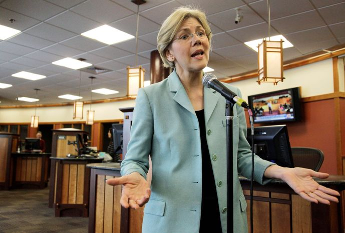 Elizabeth Warren, Democratic candidate for U.S. Senate in Massachusetts, addresses questions on her claim of Native American heritage. Ms. Warren was listed as Native American in several law school directories. (Associated Press)