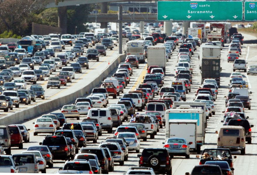 """Memorial Day weekend travel plans serve as a stark reminder of high gasoline prices, which have developed into a common source of complaint among American drivers left with no choice but to pay heavily at the pump. """"The oil companies have cornered the market and they are squeezing us for everything we have,"""" said Bob Simpson, 62, of Lodi, N.J. (Associated Press)"""