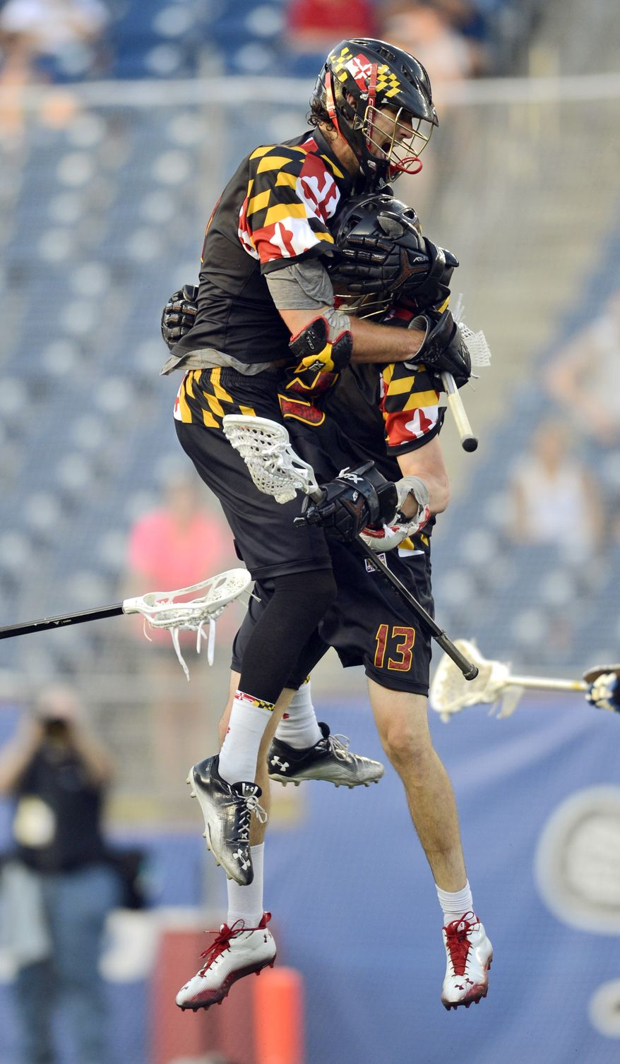 Maryland's Kevin Cooper, top and Owen Blye (13) celebrate a fourth-quarter goal in their semifinal game against Duke in the NCAA Division I college men's lacrosse championship at Gillette Stadium in Foxborough, Mass., Saturday, May 26, 2012. (AP Photo/Gretchen Ertl)