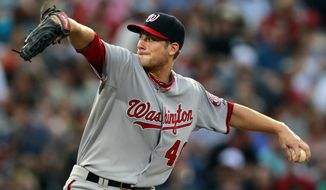 Washington Nationals starting pitcher Ross Detwiler (48) works in the first inning of baseball game against the Atlanta Braves Friday, May 25, 2012 in Atlanta. (AP Photo/John Bazemore)