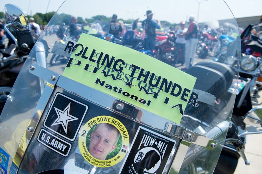 A motorcycle in the Pentagon parking lot has a sticker with the photo of PFC Bowe Bergdahl, who was captured in Afghanistan in June 2009 and who is still being held by the Taliban.  (Barbara L. Salisbury/The Washington Times)
