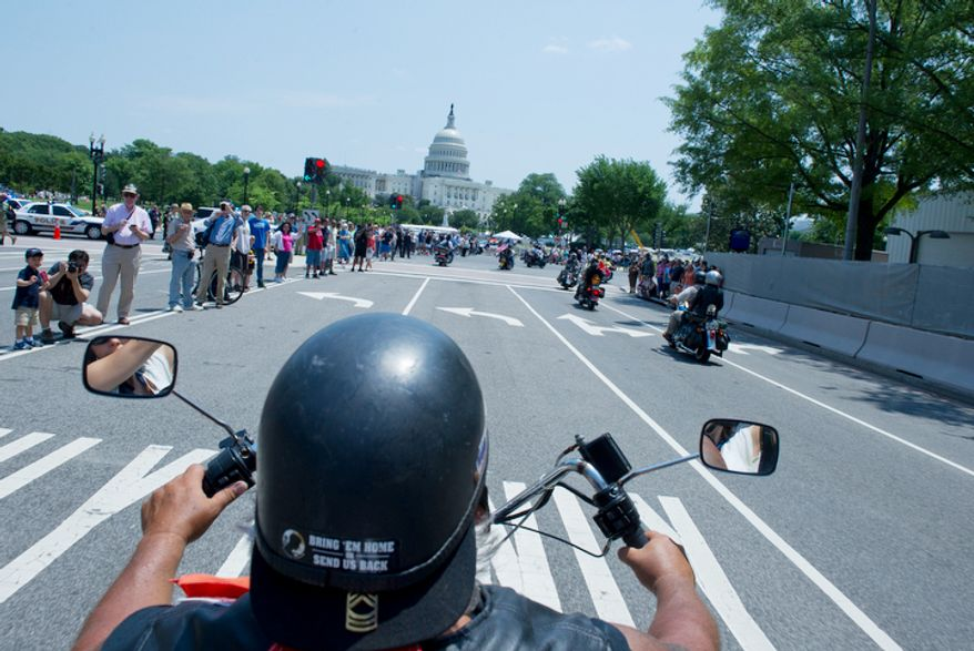 Mike Evangelho, of Brick, N.J. makes his way down Pennsylvania Avenue near the U.S. Capitol during the annual Rolling Thunder event. (Barbara L. Salisbury/The Washington Times)