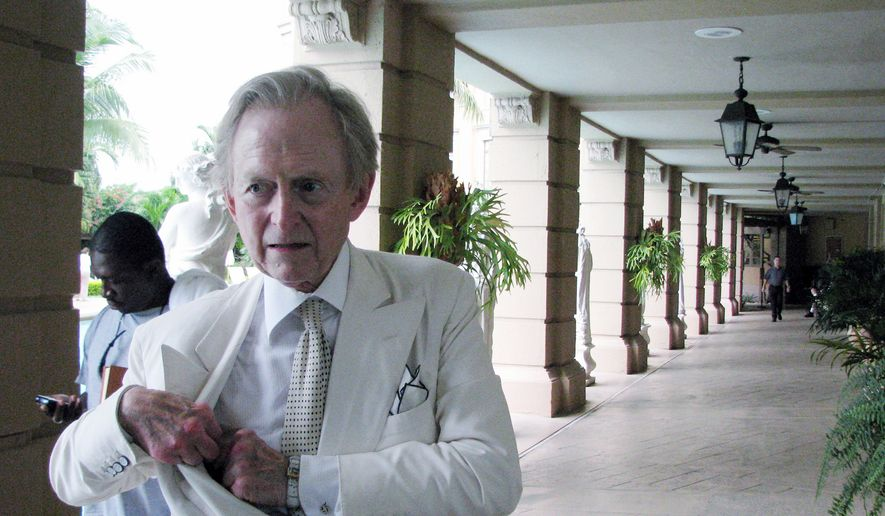 In this Oct. 13, 2008, file photo provided by Oscar Corral, writer Tom Wolfe is shown in Miami, Fla. (AP Photo/Oscar Corral) ** FILE **