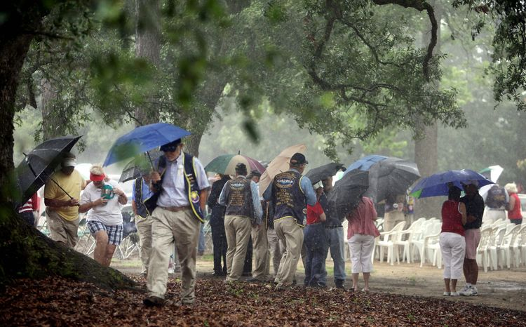People attending a Memorial Day observance head for cover just as it was about to begin when rain from Tropical Depression Beryl passed through Summerville, S.C. Holiday plans elsewhere in the Southeast were disrupted as well. (The Post and Courier via Associated Press)