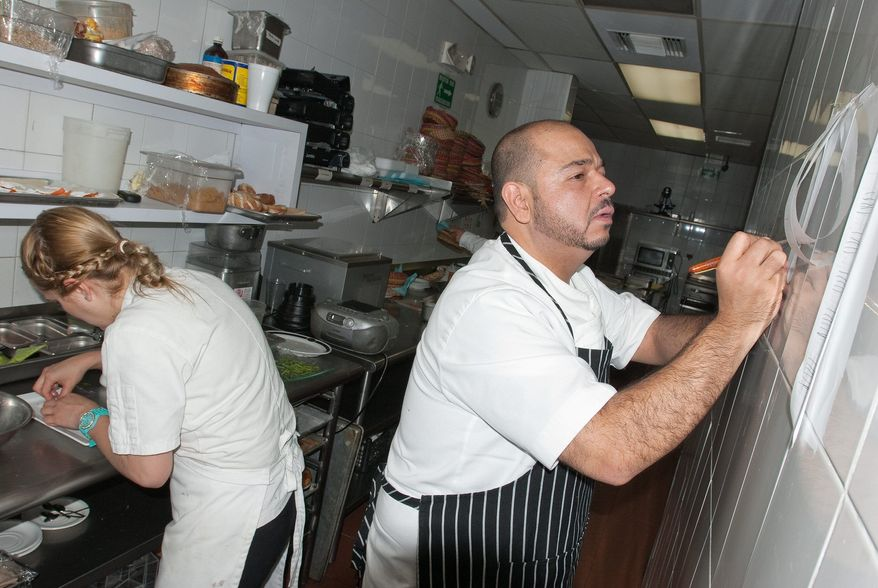 Oscar Herrera, owner and principal chef of Maria Chuchena restaurant, is back in business in Juarez after crime drove him out and sent him across the border into Texas. A declining crime rate brought him back to his native land. (Keith Dannemiller/Special to The Washington Times)