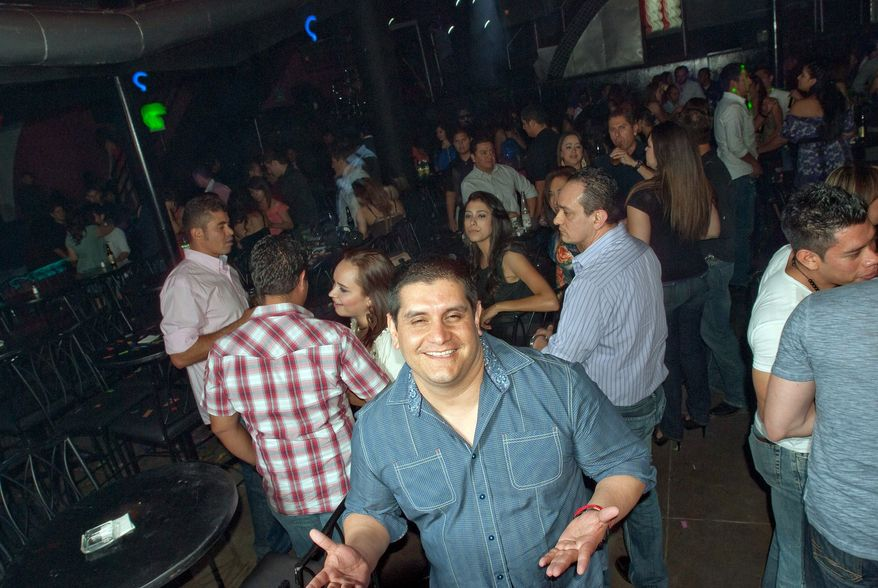 Jose Fernandez, the owner of the Quinto Elemento nightclub in Juarez, Mexico, is happy to see his club filling up again after fear of crime kept many people away and forced him to close. (Keith Dannemiller/Special to The Washington Times)