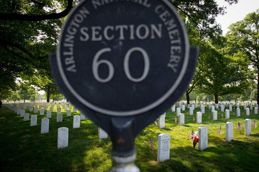The sun rises on Section 60 on Memorial Day at Arlington National Cemetery. (Rod Lamkey Jr/The Washington Times)