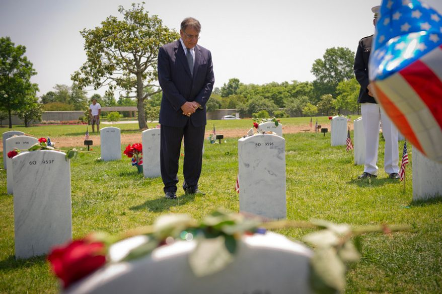 U.S. Secretary of Defense Leon Panetta visits grave sites on Memorial Day at Arlington National Cemetery in Arlington, Va., Monday, May 28, 2012. (Rod Lamkey Jr/The Washington Times)