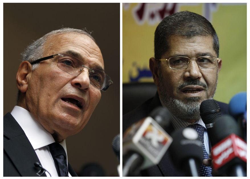 ** FILE ** Egyptian presidential candidates Ahmed Shafiq (left) and Mohammed Morsi (AP Photo/Khalil Hamra and Nasser Nasser)