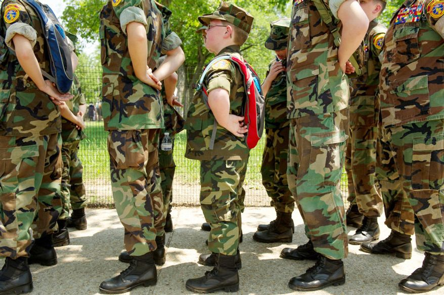 Jakob Bullock, 9, center, lines up with fellow Eno River Young Marines from Hillsborough, N.C., to march in the Memorial Day Parade. (Andrew Harnik/The Washington Times)