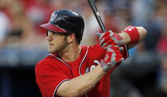 Washington Nationals left fielder Bryce Harper bats during a baseball game against the Atlanta Braves Sunday, May 27, 2012 in Atlanta. (AP Photo/John Bazemore)