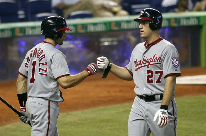 Washington Nationals' Stephen Lombardozzi (1) congratulates Jordan Zimmermann after he hit a solo home run against the Miami Marlins during the third inning of a baseball game at Marlins Park in Miami, Monday, May 28, 2012. The Marlins won 5-3. (AP Photo/Joel Auerbach)