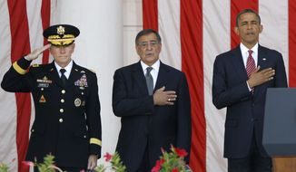 President Barack Obama, right, Defense Secretary Leon Panetta, center, and Chairman of the Joint Chiefs of Staff Gen. Martin Dempsey, stand during the singing of the National Anthem at the Memorial Day Observance at the Memorial Amphitheater at Arlington National Cemetery, Monday, May 28, 2012. (AP Photo/Charles Dharapak)