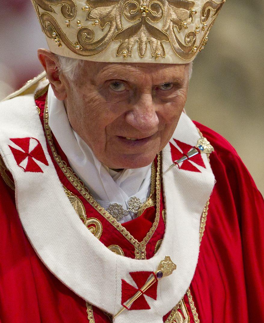 Pope Benedict XVI celebrates a Pentecost Mass inside St. Peter's Basilica, at the Vatican, Sunday, May 27, 2012. (AP Photo/Andrew Medichini)