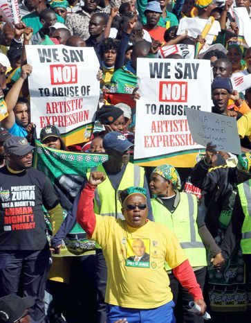Supporters of South Africa's ruling party sing as they march through Johannesburg to the Goodman Gallery on Tuesday to protest the now-removed painting by a white artist of Mr. Zuma. (Associated Press)