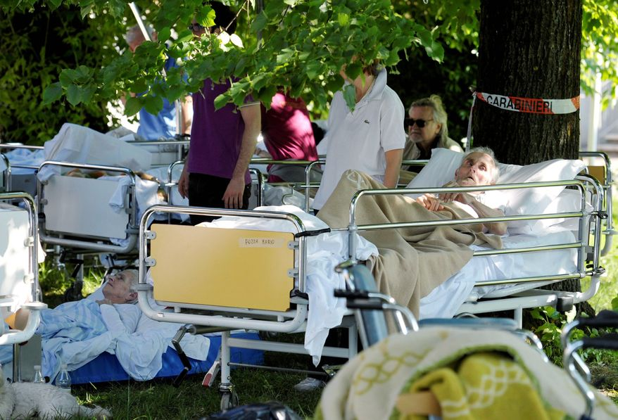 "Elderly patients from a hospital in Mirandola were evacuated to the shade of trees. Prime Minister Mario Monti pledged his government would do ""all that is possible ... to guarantee the resumption of normal life in this area that is so special, so important and so productive for Italy."" (Associated Press)"