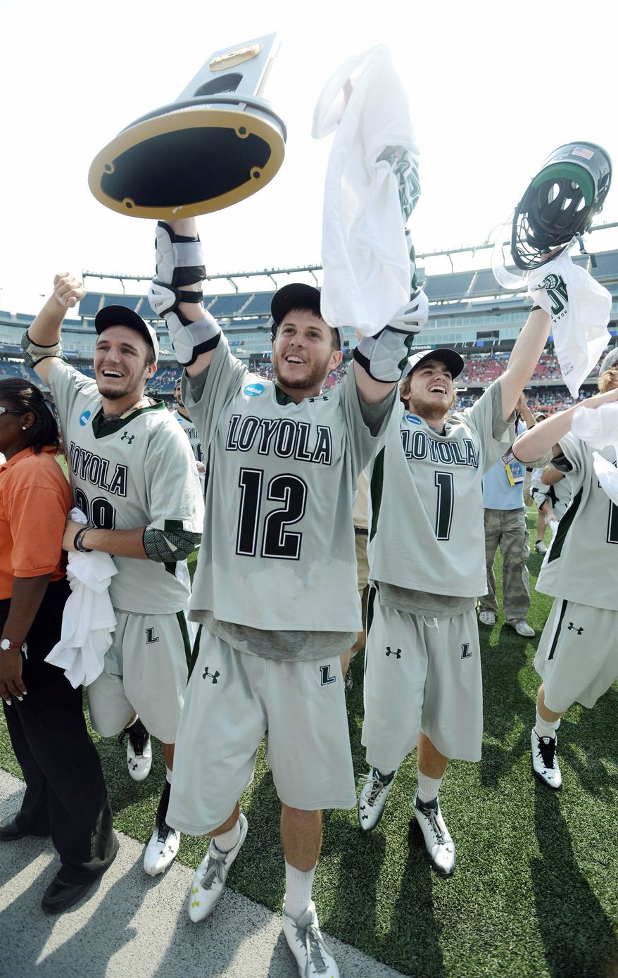 Loyola players (from left) T.J. Harris, Eric Lusby and Michael Bonitatibus celebrated the school's first lacrosse championship after beating Maryland 9-3 on Monday. Lusby, who scored a tournament-record 17 goals, won't be back next season.