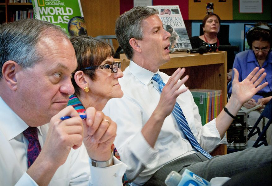 From left, New Haven Mayor John DeStefano, Rep. Rosa L. DeLauro and Education Secretary Arne Duncan participate in a roundtable discussion on education reform at Jepson School in New Haven, Conn., on Tuesday. (Associated Press)