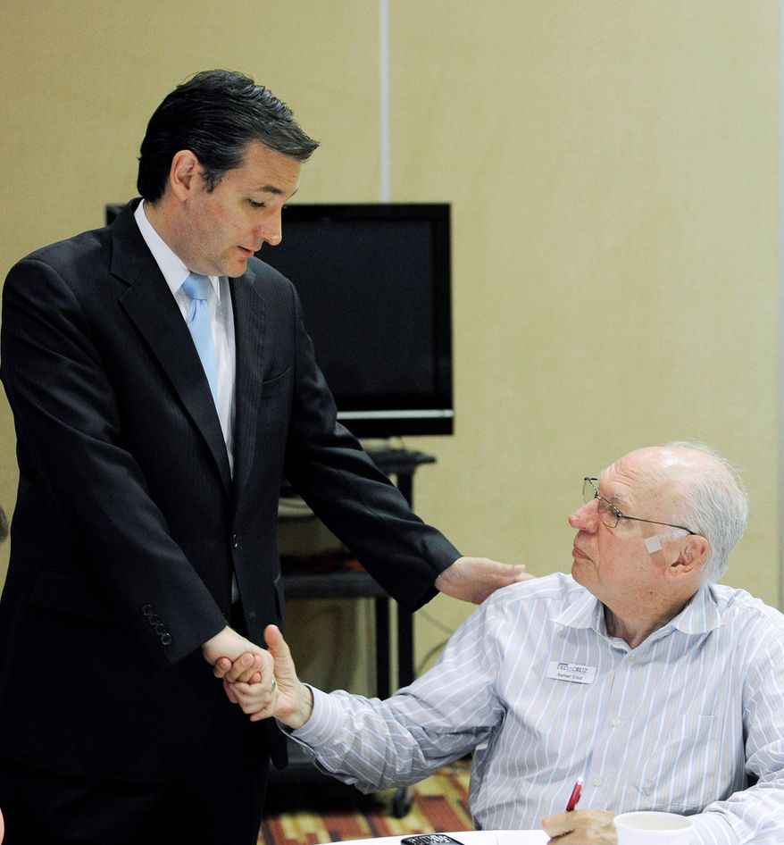 Ted Cruz, a GOP Senate hopeful, talks with his father, Rafael Cruz, as he works at the campaign's phone bank in Houston on Tuesday. Mr. Cruz, a former Texas solicitor general and the son of a Cuban-American immigrant, is banking on getting into a one-on-one runoff with the longtime lieutenant governor. (Associated Press)