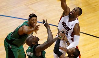 Dwyane Wade (right) scored 22 points in Game 1 for Miami, which had far too easy of a time in beating Boston 93-79 on Monday night. LeBron James led the Heat with 32 points. (Associated Press)