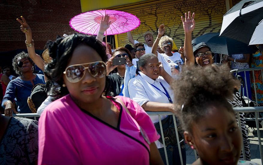 People waiting in line in the heat cheer the arrival of Council Member Marion Barry (Ward 8) as he arrives to view the body of Chuck Brown as he lies in repose at the Howard Theatre in Washington, D.C., Tuesday, May 29, 2012. Mr. Brown died on May 16, 2012. He was 75.(Rod Lamkey Jr/The Washington Times)