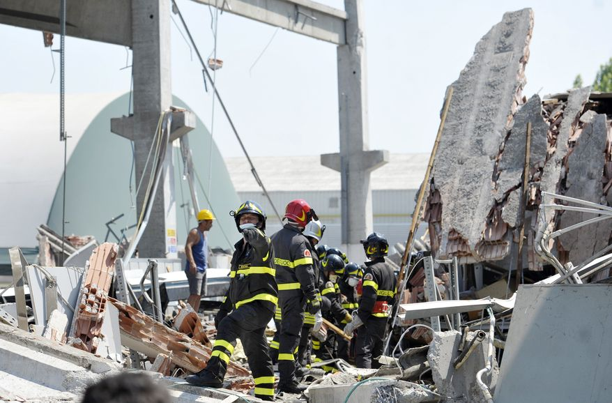 Italian firefighters search the debris of a collapsed factory in Mirandola, northern Italy, Tuesday, May 29, 2012. A magnitude 5.8 earthquake struck the same area of northern Italy stricken by another fatal tremor on May 20. (AP Photo/Marco Vasini)