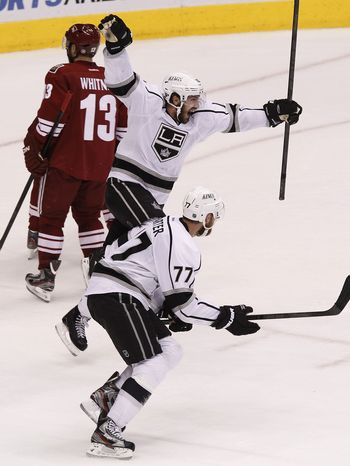 Los Angeles Kings' Mike Richards (top) and Jeff Carter (bottom) have combined for eight goals and 20 points in the playoffs. (AP Photo/Ross D. Franklin)