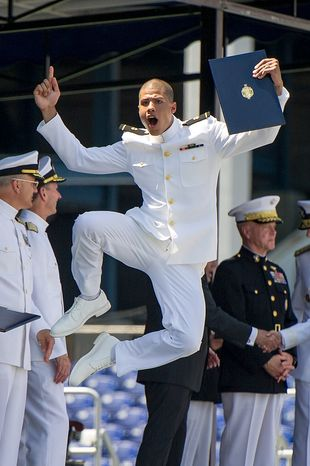 Midshipman Edwin Conrad jumps with joy as he receives his diploma during the Graduation ceremony the U.S. Naval Academy's class of 2012 at the Navy-Marine Corps Stadium, Annapolis, Md., Tuesday, May 29, 2012. (Andrew Harnik/The Washington Times)