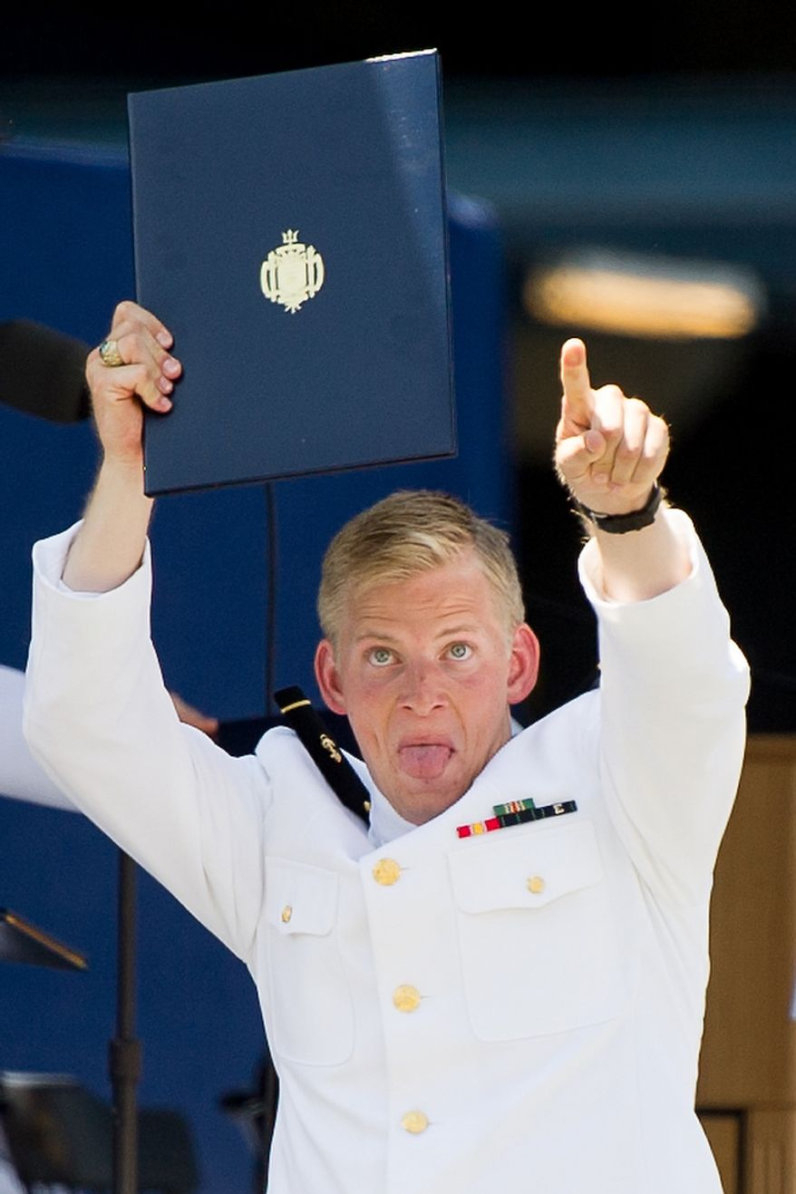 A NSNA Midshipman points towards the bleachers as he receives his Diploma during the Graduation ceremony the U.S. Naval Academy's class of 2012 at the Navy-Marine Corps Stadium, Annapolis, Md., Tuesday, May 29, 2012. (Andrew Harnik/The Washington Times)