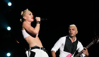 ** FILE ** In this Sept. 25, 2009, file photo, Gwen Stefani, left, and Tony Kanal from the U.S. band No Doubt perform at the F1 Rocks concert in Singapore. (AP Photo/Joan Leong, file)