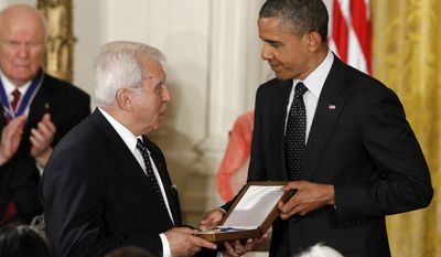 President Obama awards the Medal of Freedom to former Polish Foreign Minister Adam Daniel Rotfeld who is accepting for Jan Karski, a resistance fighter against the Nazi occupation of Poland during World War II, during a ceremony in the East Room of the White House in Washington, Tuesday, May 29, 2012. (AP Photo/Charles Dharapak)