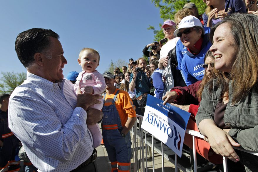 Republican presidential candidate and former Massachusetts Gov. Mitt Romney holds a baby May 29, 2012, while greeting supporters after a campaign event in Craig, Colo. (Associated Press)
