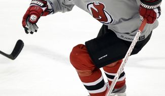 New Jersey Devils' Ilya Kovalchuk leads the NHL in points, with 18, during the playoffs. (AP Photo/Julio Cortez)