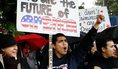 **FILE** Undocumented college student Jorge Herrera, 18, (center) of Carson, Calif., rallies with students and Dream Act supporters in Los Angeles on Dec. 25, 2010. The Dream Act would have given provisional legal status to illegal immigrants brought to the country as children. (Associated Press)