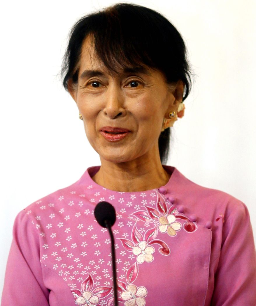"""It's so rare to see grace trump military might, and when it happens we should make the most joyful noise we can,"" Bono says of Mrs. Suu Kyi, who spent 15 of the past 24 years and is now a member of Parliament. (Associated Press)"