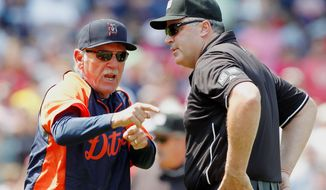 Tigers manager Jim Leyland (left) argues with first base umpire Tim Brookens after being ejected Monday. The dispute stemmed over a blown call on a what would have been a Red Sox strikeout. (Associated Press)