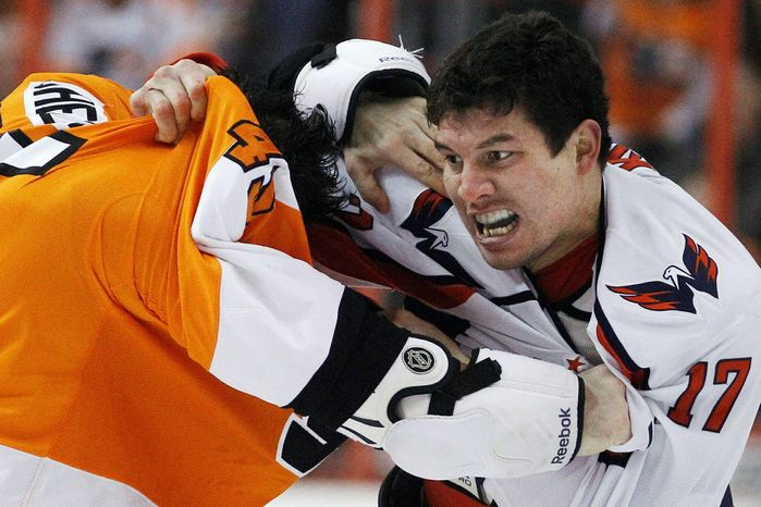 Washington Capitals' D.J. King (17) struggles with Philadelphia Flyers' Jody Shelley (45) as the two fight in the first period of an NHL hockey game Tuesday, Jan. 18, 2011, in Philadelphia. (AP Photo/Matt Slocum)