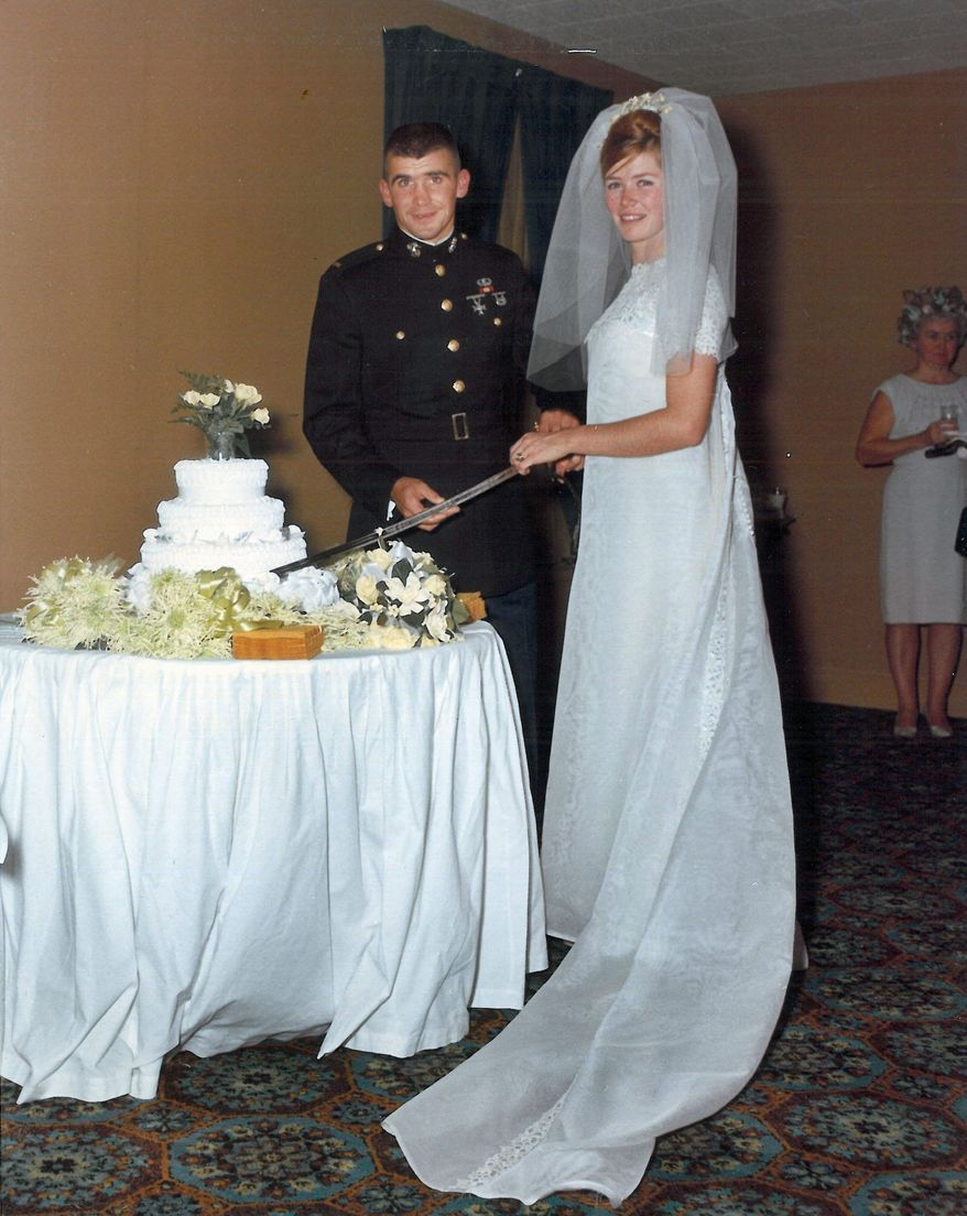 Oliver North cuts his wedding cake in 1968 with his ceremonial sword as his wife looks on. The sword was stolen and returned decades later. (Photograph courtesy Oliver North)