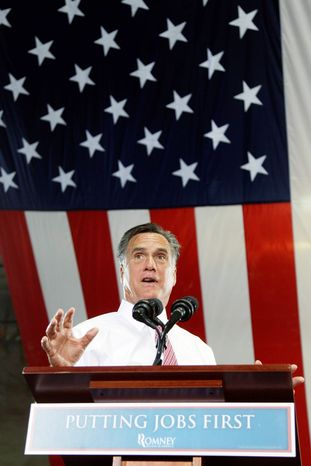 """Team Obama shifted from attacking Mitt Romney's tenure at Bain Capital to his record on jobs in Massachusetts, which it called """"among the worst in the nation."""" (Associated Press)"""