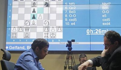 World Chess champion Viswanathan Anand from India, left, and his Israeli challenger Boris Gelfand play a FIDE World Chess Championship tie break match at Moscow's Tretyakovsky State Gallery in Moscow, Russia, Wednesday, May 30, 2012. (AP Photo/Misha Japaridze)