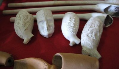 A collection of clay and ceramic pipes collected by underwater archaeologists from the remains of the submerged Jamaican city of Port Royal, is shown to the media during a press conference in Port Royal, Jamaica, Tuesday, May 29, 2012. (AP Photo/David McFadden)
