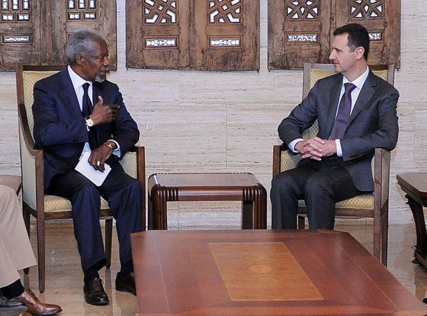 Syrian President Bashar Assad (right) meets with former U.N. Secretary-General Kofi Annan, the U.N.-Arab League joint special envoy for Syria, in Damascus, Syria, on Tuesday, May 29, 2012. (AP Photo/SANA)