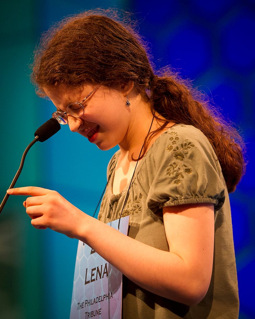 Lena Greenberg, 14, of Philadelphia, Pa., works on spelling her word during the preliminary rounds of the 2012 Scripps National Spelling Bee at the Gaylord National Resort and Convention Center in National Harbor, Md., Wednesday, May 30, 2012. This year, 278 spellers from around the United States and all walks of life will compete for the title of 2012 Scripps National Spelling Bee champion. Lena spelled her word, jong, correctly. (Rod Lamkey Jr/The Washington Times)