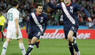 United States Herculez Gomez, center, scored the Americans' goal in a 4-1 loss to Brazil at FedEx Field on Wednesday night.  (AP Photo/Luca Bruno)