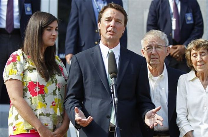 ** FILE ** John Edwards speaks May 31, 2012, outside a federal courthouse as his daughter Cate Edwards (left) and parents Wallace Edwards (second from right) and Bobbie Edwards look on after the jury's verdict in his trial on charges of campaign corruption in Greensboro, N.C. (Associated Press)