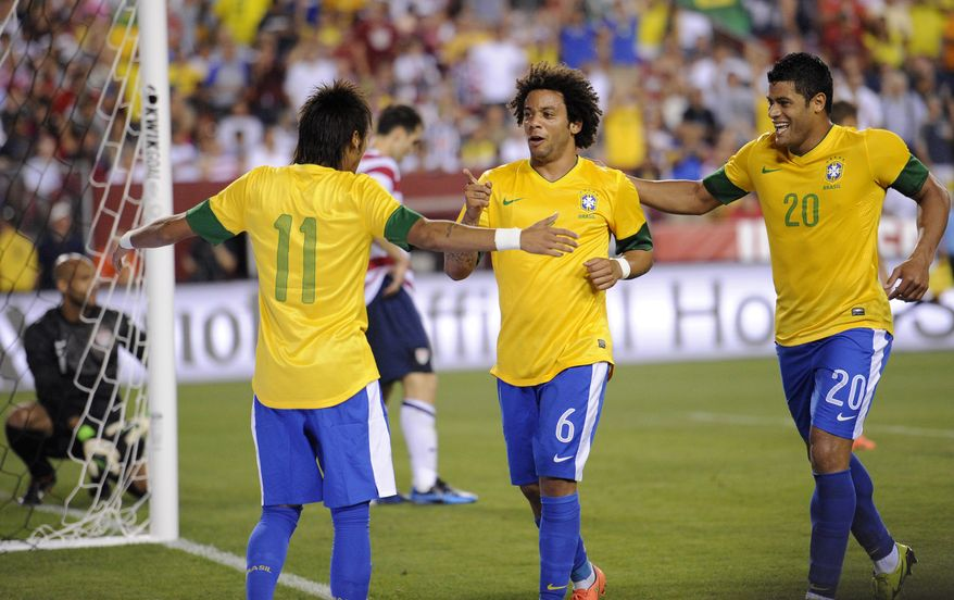 Brazil's Marcelo (6) celebrates his goal with Neymar (11) and Hulk (20) during the second half of an international friendly soccer match against the United States on Wednesday, May 30, 2012, in Landover, Md. Brazil won 4-1. (AP Photo/Nick Wass)