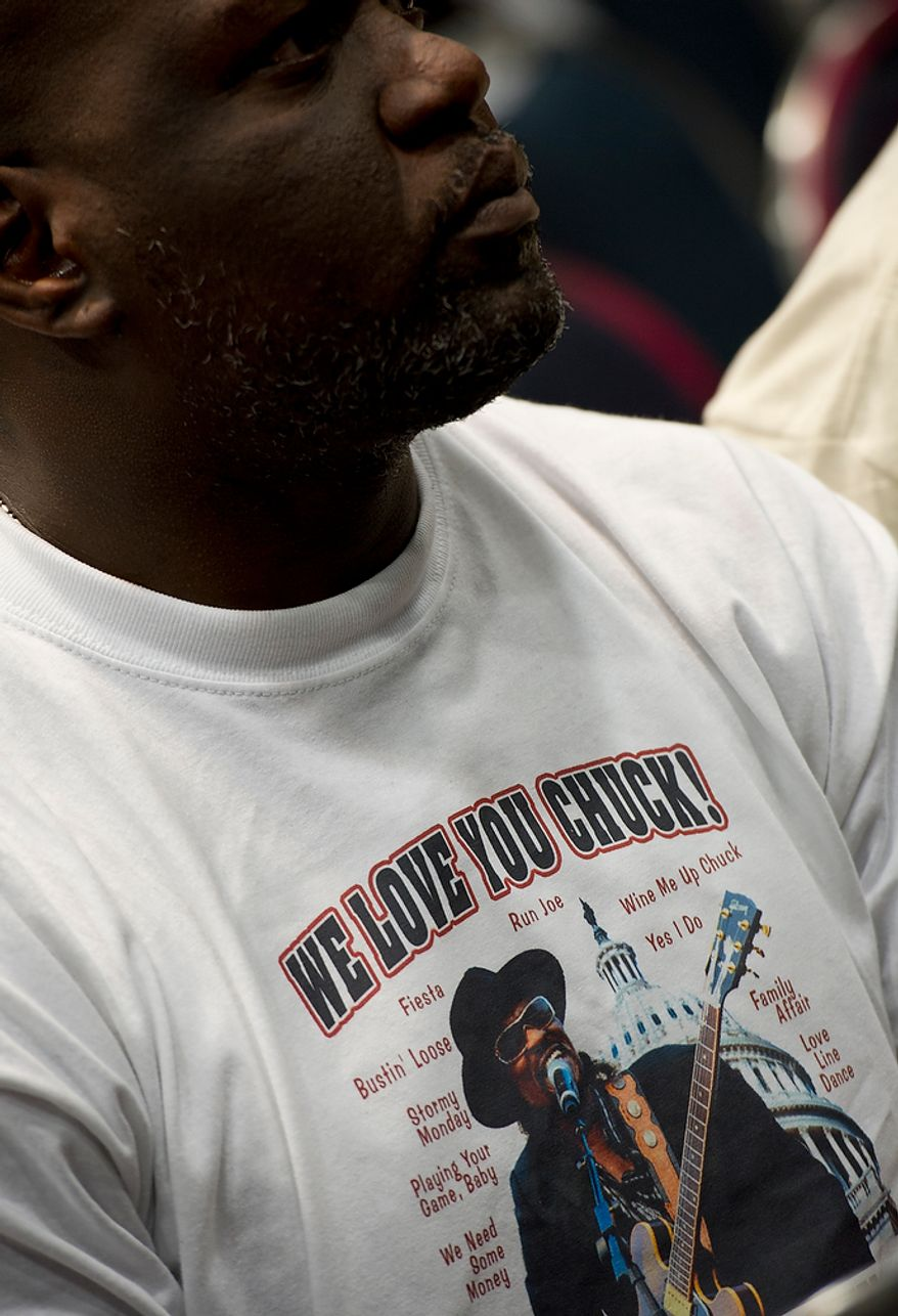 """A man wears a """"We Love You Chuck!"""" shirt at the memorial service for D.C. Go Go icon Chuck Brown  Thursday, May 31, 2012 at the Washington Convention Center in Washington, D.C. (Barbara L. Salisbury/The Washington Times)"""